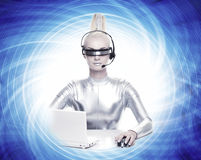 Cyber woman working on her laptop Stock Images