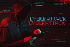 Cyberattack concept with faceless hooded male person stock photo