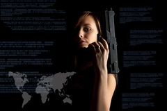 Cybercrime concept. Woman in black background with gun, cyber attack, cyber terrorism, cybercrime concept Royalty Free Stock Photography