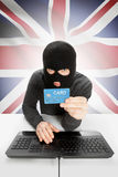 Cybercrime concept with national flag on background - United Kingdom Royalty Free Stock Images
