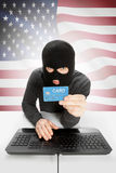 Cybercrime concept with national flag on background - United States Stock Photo
