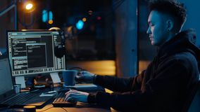 Hacker using computer for cyber attack at night stock footage