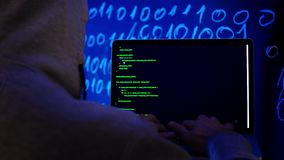 Hacker in dark room writing programming code or using virus program for cyber attack. Cybercrime Hacking Technology Concept. Hacker in dark room writing stock video
