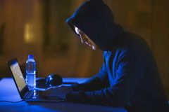 Hacker using laptop computer for cyber attack Royalty Free Stock Image