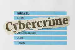 Cybercrime. Newspaper cutout over an email inbox abstract Stock Images