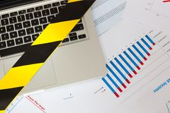 Laptop secured by Police - yellow tape Stock Photography