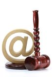 Cybercrime. Wooden gavel with @-symbol isolated on white background Stock Image