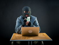 Cybercriminal man counts euro Royalty Free Stock Photography