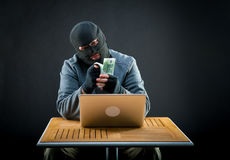 Cybercriminal man counts euro Stock Images