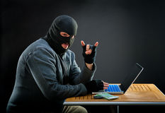 Cybercriminal man Stock Image