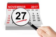 Cybermåndag begrepp 27 November 2017 kalender med förstoringsapparaten Royaltyfria Bilder