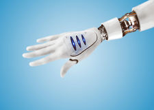 Cybernetic arm. With mechanical parts on display royalty free stock images