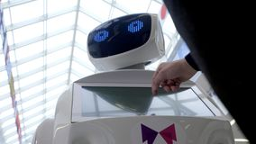 Cybernetic system today. Modern Robotic Technologies. Humanoid autonomous robot. a man using his touch screen. High tech