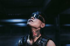 Free Cyberpunk Style. Tattooed Guy In One City. Cyber Glasses. Stock Photography - 196457972