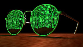 Cybersecurity concept with sunglasses reflecting green matrix sc Royalty Free Stock Images
