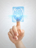Cybersecurity. Hand pushing fingerprint symbolising modern cybernetic security Royalty Free Stock Images