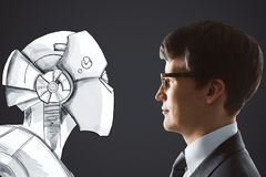 Cyberspace and robotics concept. Side portrait of handsome young businessman facing drawn robot on black background. Cyberspace and robotics concept Royalty Free Stock Image