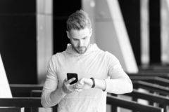 Cybersport. man hold smartphone and look at smart watch, cybersport. digital sport and cybersport concept. cybersport royalty free stock photography