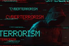 Cyberterrorism concept with faceless hooded male person stock images