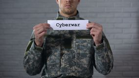 Cyberwar word written on sign in hands of male soldier, information security stock video