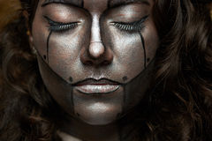 Cyborg with closed eyes. Macro of woman cyborg makeup with closed eyes royalty free stock images
