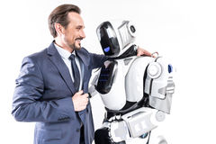 Cyborg de abarcamiento sonriente alegre del hombre Imágenes de archivo libres de regalías