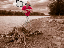 Cyborg Photographer taking photo. A humorous image of a cyborg photographer taking a photo of a tree stump Royalty Free Stock Image