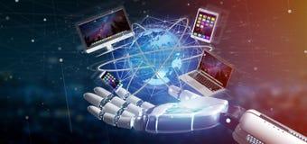 Cyborg ręka trzyma komputer i przyrząda wystawiającymi na futuri zdjęcie royalty free