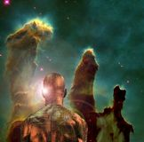 Cyborg space. Surreal digital art. Man with electric circuit pattern on his skin stands before nebula pillars in deep space. Human elements were created with 3D stock illustration