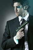 Cyborg spy. With a gun. Android and robot conceptual Royalty Free Stock Photography