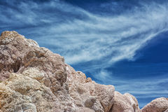 Cyclades blue sky and volcanic rock Stock Photography