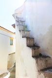 Cyclades, Greece - White exterior stairway. On a traditional house Stock Image