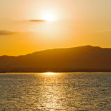 In cyclades  hill    greece sunset and the sky mediterranean red Stock Photos