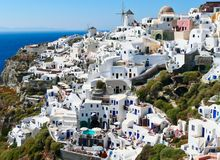 Cycladic Architecture, Oia, Overlooking the Aegean Sea, Santorini, Greece. Picturesque closely packed typical Cycladic white architectural buildings at Oia royalty free stock photos