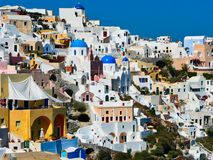 Cycladic Architecture, Oia, Santorini, Greece. Picturesque closely packed typical Cycladic white architectural buildings at Oia, Santorini, a Cycladic Aegean royalty free stock photos