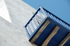 Cycladic balcony. Balcony of a building in an abstract fashion in Cyclades Greece Stock Photos