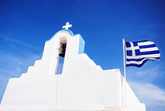 Cycladic church with greek flag, Greece. Beautiful view of cycladic church with greek flag, Greek islands Royalty Free Stock Image