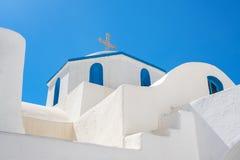 Cycladic greek orthodox church on Paros island. Greece. White cross against blue sky stock image