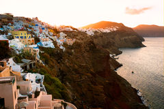 Cycladic Homes Along the Cliff of Oia, Santorini, Greece. The village of Oia, although devastated by the 1956 earthquake, still remains a dramatic and striking stock photos
