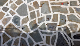 Cycladic stone floor. Detail of cycladic architecture - irregular stone floor with white joints royalty free stock image