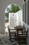 Cycladic terrace. Cycladic architecture detail - terrace with table and chairs stock photo