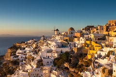 Cycladic village Oia at sunset Royalty Free Stock Photo