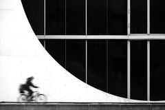 Cycle. Bicycle passing architecture in Berlin Royalty Free Stock Photos