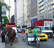 Cycle carriages rickshaw and cabs in New York city. Various forms of transportation in new york from carriage to cabs to cycles to rickshaws Stock Images