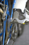 Cycle details and man's foot in sporting shoe Royalty Free Stock Photography