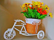 Cycle, dolls, art, interior decoration indoor child kid toy flowers flower bouquet fun stock images