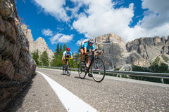 Cycle downhill - road cycling man is following woman. Follower endurance race in action Stock Photos
