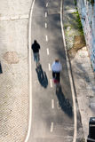 Cycle lane along Tiber rive in Rome. Overhead shot of  the cycle lane along Tiber river with a couple of cyclist motion blurred Stock Photos