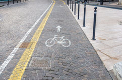 Cycle Lane on a Cobbled Street Stock Image