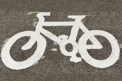 Cycle lane painted bicycle symbol Royalty Free Stock Photo